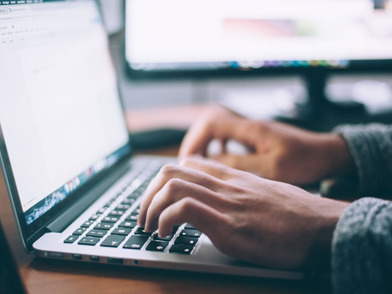 writing at a computer